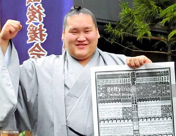 Mongolian wrestler Terunofuji poses for photographs as he promoted to Sekiwake on February 23 2015 in Osaka Japan