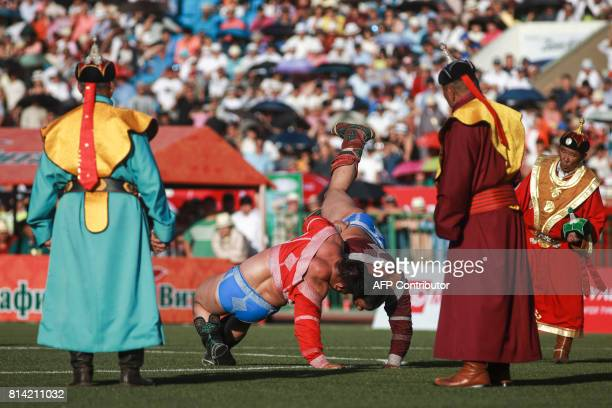 TOPSHOT Mongolian wrestlers fight during the traditional Nadaam festival in Ulan Bator on July 12 2017 The festivities consist of a number of...