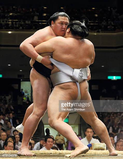 Mongolian wrestlers Kyokutenho and Takanoiwa compete in day four of the Grand Sumo Summer Tournament at Ryogoku Kokugikan on May 13 2015 in Tokyo...