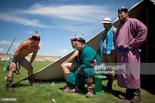 Mongolian wrestlers prepare for matches during a Naadam festival Mongolian pastoral herders make up one of the world's largest remaining nomadic...