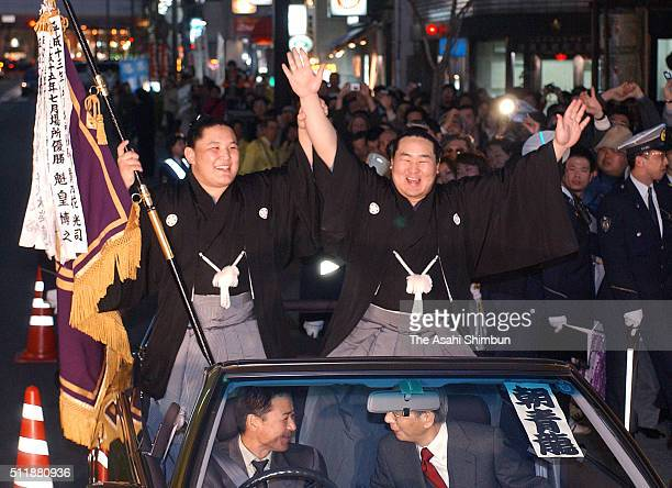 Mongolian yokozuna Asashoryu celebrates during the victory parade after winning the Grand Sumo Spring Tournament at the Osaka Prefecture Gymnasium on...