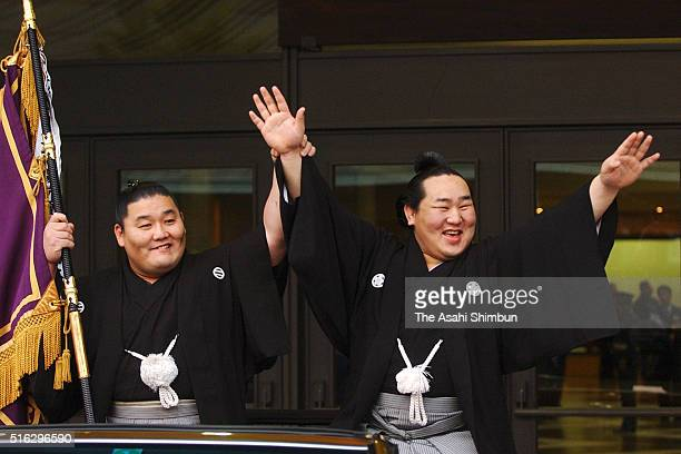 Mongolian yokozuna Asashoryu celebrates winning the tournament at the victory parade after the Grand Sumo Summer Tournament on May 25 2003 in Tokyo...