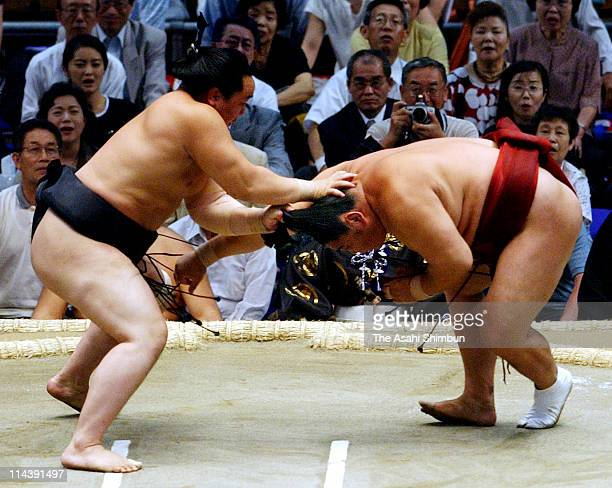 Mongolian yokozuna Asashoryu grabs the topknot of fellow sumo wrestler Kyokushuzan during the day five of the Grand Sumo Nagoya Tournament at Aichi...
