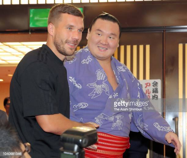 Aminishiki thtrows Takekaze to win in his juryo rank bout on day eleven of the Grand Sumo Autumn Tournament at Ryogoku Kokugikan on September 19 2018...