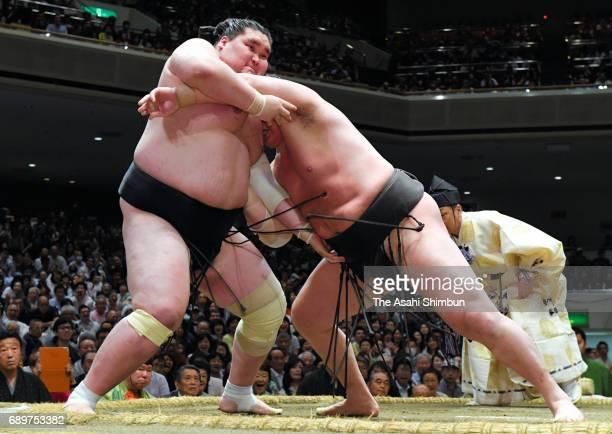 Mongolian yokozuna Hakuho and Mongolian ozeki Terunofuji compete during day fourteen of the Grand Sumo Summer Tournament at Ryogoku Kokugikan on May...
