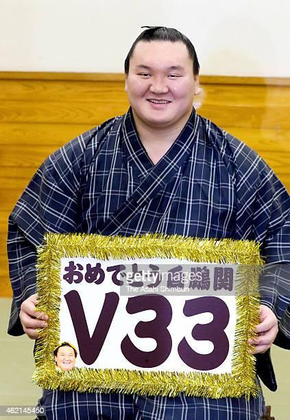 Mongolian yokozuna Hakuho celebrates his 33rd career win after beating ozeki Kisenosato in the dressing room during day thirteen of the Grand Sumo...