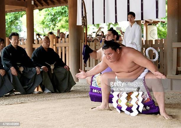 Mongolian yokozuna Hakuho performs the 'DohyoIri' ring purification ritual at Atsuta Jingu Shrine ahead of the Grand Sumo Nagoya Tournament on July 4...