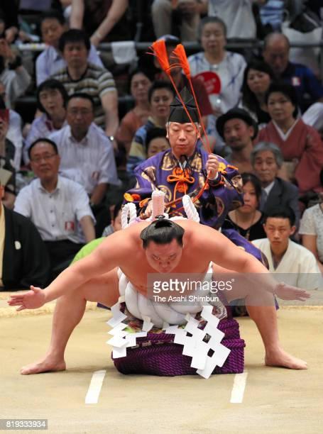 Mongolian yokozuna Hakuho performs the 'Dohyoiri' ring purification ritual during day twelve of the Grand Sumo Nagoya Torunament at Aichi Prefecture...