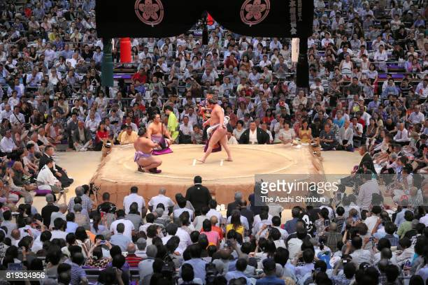 Mongolian yokozuna Hakuho performs the 'Dohyoiri' ring purification ritual during day twelve of the Grand Sumo Nagoya Torunament at Aichi Prefecture...