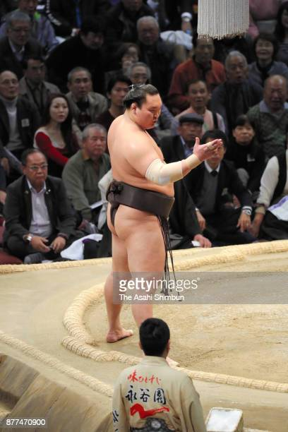 Mongolian yokozuna Hakuho protests after his defeat by sekiwake Yoshikaze during day eleven of the Grand Sumo Kyushu Tournament at Fukuoka Convention...
