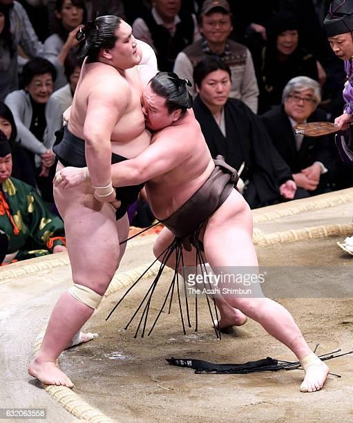 Mongolian yokozuna Hakuho pushes Mongolian ozeki Terunofuji to win during day eleven of the Grand Sumo New Year Tournament at Ryogoku Kokugikan on...