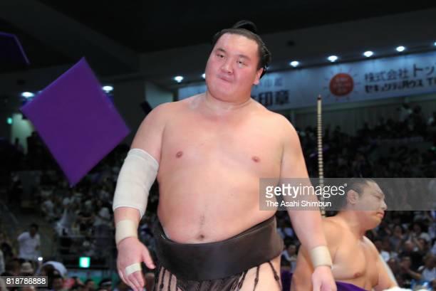 Mongolian yokozuna Hakuho reacts after his defeat by sekiwake Mitakeumi during day eleven of the Grand Sumo Nagoya Torunament at Aichi Prefecture...