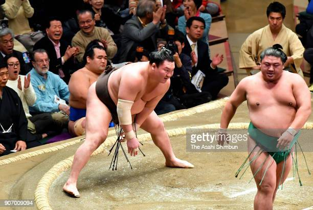 Mongolian yokozuna Hakuho reacts in the dressing room after his defeat by Yoshikaze during day four of the Grand Sumo New Year Tournament at Ryogoku...