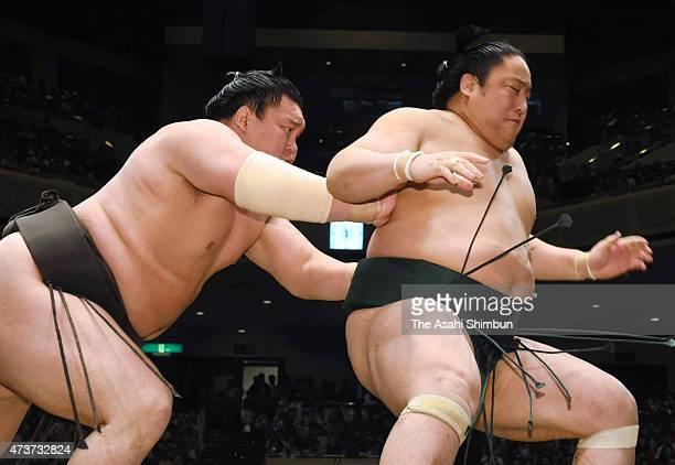 Mongolian yokozuna Hakuho sends Sadanoumi out of the ring to win in day seven of the Grand Sumo Summer Tournament at Ryogoku Kokugikan on May 16 2015...