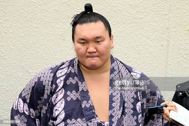 Mongolian yokozuna Hakuho speaks to media reporters on the late Japan Sumo Association President stabel master Kitanoumi after a morning practice on...