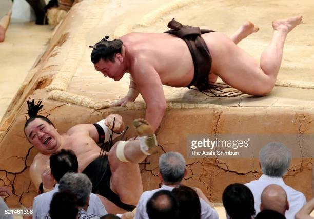 Mongolian yokozuna Hakuho throws his fellow yokozuna Harumafuji to win the tournament during day fifteen of the Grand Sumo Nagoya Torunament at Aichi...