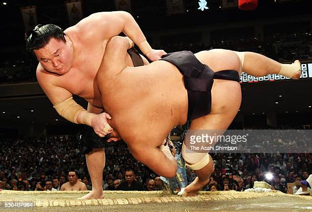 Mongolian yokozuna Hakuho throws Myogiryu to win during day three of the Grand Sumo Summer Tournament at Ryogoku Kokugikan on May 10 2016 in Tokyo...