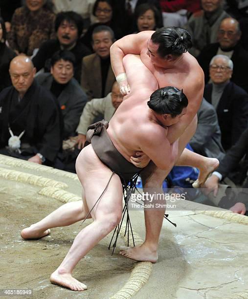 Mongolian yokozuna Hakuho whose real name is Munkhbat Davaajargal pushes his fellow Ozeki Kakuryu whose real name is Mangaljalavyn Anand to win in...
