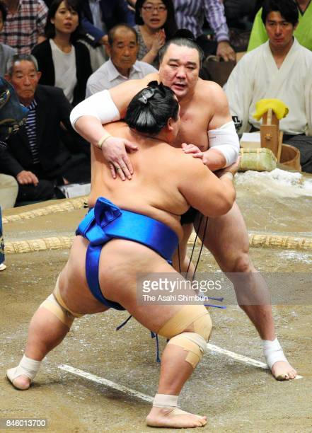 Mongolian yokozuna Harumafuji and Kotoshogiku compete during day three of the Grand Sumo Autumn Tournament at Ryogoku Kokugikan on September 12 2017...