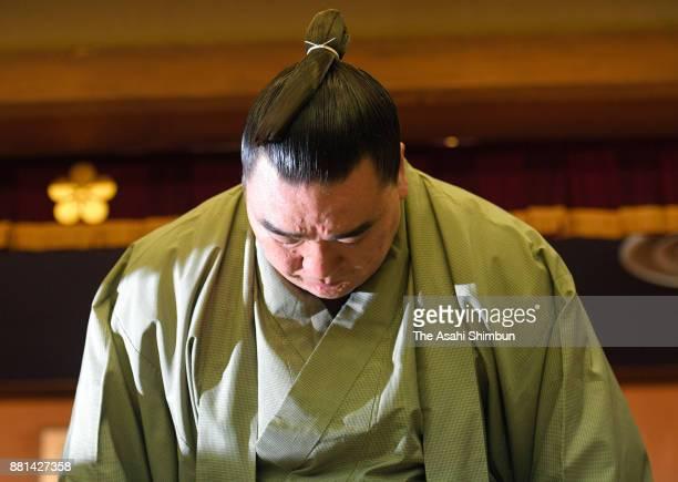 Mongolian yokozuna Harumafuji bows during a press conference on his retirement on November 29 2017 in Dazaifu Fukuoka Japan Harumafuji submitted his...