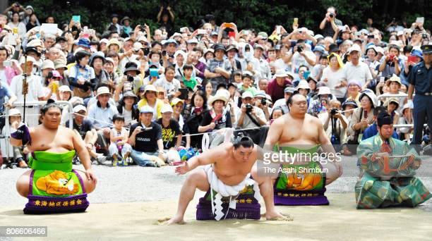 Mongolian yokozuna Harumafuji performs the Dohyoiri ring purification ritual at Atsuta Jingu Shrine ahead of the Grand Sumo Nagoya Tournament on July...