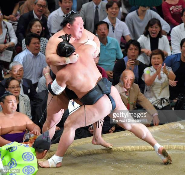 Mongolian yokozuna Harumafuji pushes ozeki Goeido out of the ring to win during day fifteen of the Grand Sumo Autumn Tournament at Ryogoku Kokugikan...