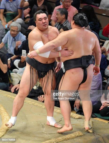 Mongolian yokozuna Harumafuji pushes ozeki Goeido to win the tournament in the championship playoff during day fifteen of the Grand Sumo Autumn...