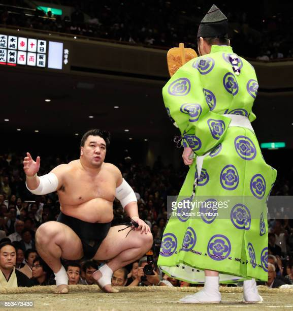 Mongolian yokozuna Harumafuji reacts after his victory in the championship playoff against ozeki Goeido during day fifteen of the Grand Sumo Autumn...