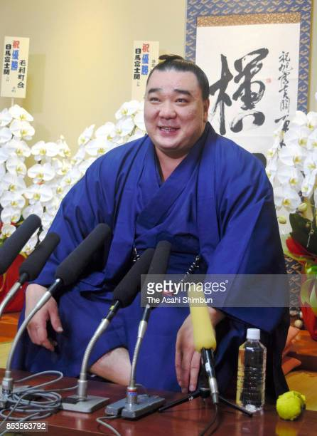 Mongolian yokozuna Harumafuji speaks during a press conference a day after winning the Grand Sumo Autumn Tournament at Isegahama Stable on September...