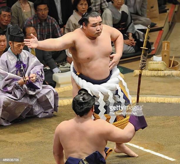 Mongolian yokozuna Kakuryu performs the 'Dohyoiri' ring purification ritual during day one of the Grand Sumo Summer Tournament at Ryogoku Kokugikan...