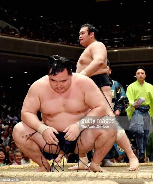 Mongolian yokozuna Kakuryu reacts after his defeat by Chiyonokuni during day two of the Grandu Sumo Summer Tournament at Ryogoku Kokugikan on May 15...