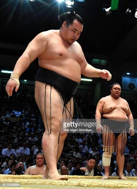 Mongolian yokozuna Kakuryu reacts after his defeat by Hokutofuji during day three of the Grand Sumo Nagoya Torunament at Aichi Prefecture Gymnasium...