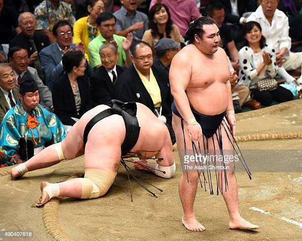 Mongolian yokozuna Kakuryu reacts after winning the tournament through the playoff against his fellow ozeki Terunofuji during day fifteen of the...