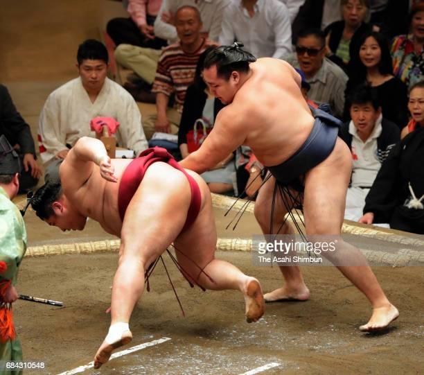 Mongolian yokozuna Kakuryu throws Endo to win during day three of the Grand Sumo Summer Tournament at Ryogoku Kokugikan on May 16 2017 in Tokyo Japan