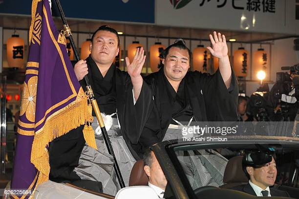Mongolian yokozuna Kakuryu waves to fans at the victory parade after winning the Grand Sumo Kyushu Tournament at Fukuoka Convention Center on...