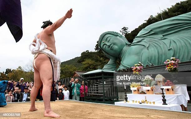 Mongolian yokozuna sumo grand champion Hakuho performs the 'DohyoIri' ring purification ritual in front of the reclining Buddha at Nanzoin Temple on...