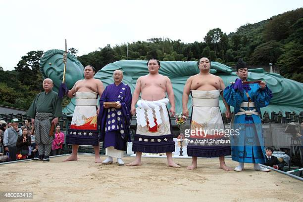 Mongolian yokozuna sumo grand champion Hakuho poses for photographs after performing the 'DohyoIri' ring purification ritual in front of the...