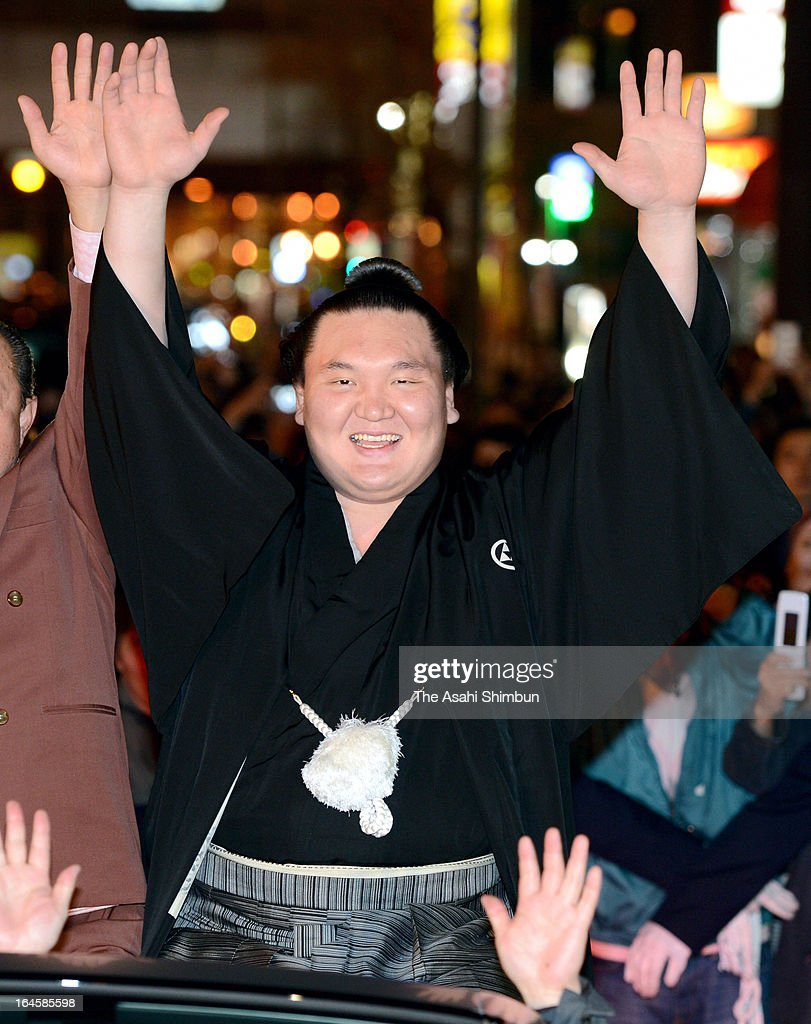Mongolian yokozuna, sumo grand champion Hakuho, whose real name is Monkhbatyn Davaajargal, celebrates at the winning parade after day fifteen of the Grand Sumo Spring tournament at Osaka Prefecture Gymnasium on March 24, 2013 in Osaka, Japan.