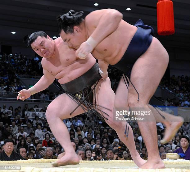 Mongolian yokozuna sumo grand champion Hakuho whose real name is Monkhbatyn Davaajargal throws fellow ozeki Kakuryu whose real name is Mangaljalavyn...