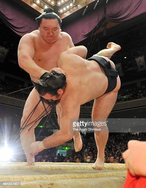 Mongolian yokozuna sumo grand champion Hakuho whose real name is Munkhbat Davaajargal throws Bulgarian ozeki Kotooshu whose real name is Kalojan...