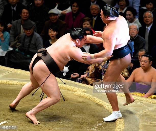 Mongolian yokozuna sumo grand champion Hakuho whose real name is Munkhbat Davaajargal pushes his fellow wrestler Kyokutenho whose real name is...