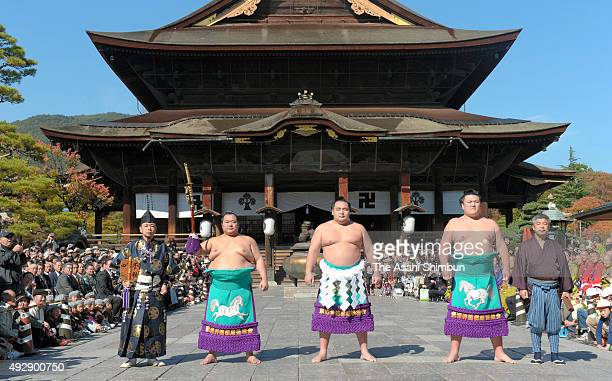 Mongolian yokozuna, sumo grand champion Kakuryu and other sumo wrestlers and gyoji, the sumo judges line up prior to the 'Dohyo-Iri', ring-entering...