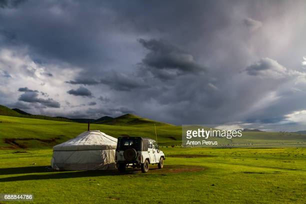 mongolian yurt against a stormy sky - yurt stock pictures, royalty-free photos & images