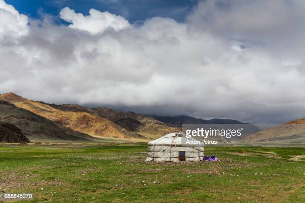 Mongolian Yurt in the background of the cloudy sky in the desert