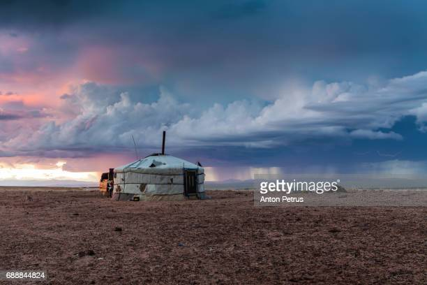 Mongolian yurts against a stormy sky