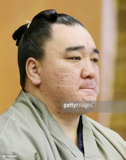 Mongolianborn yokozuna or grand champion Harumafuji bites his lips at a press conference to announce his retirement in Dazaifu Fukuoka prefecture on...