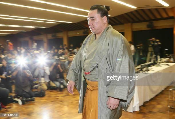 Mongolianborn yokozuna or grand champion Harumafuji leaves the room after a press conference to announce his retirement in Dazaifu Fukuoka prefecture...