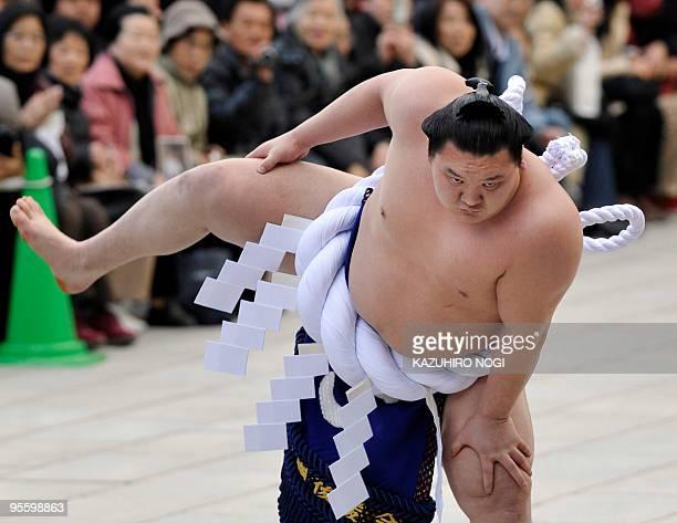 Mongolian-born 'yokozuna', or sumo grand champion, Hakuho demonstrates a ceremonial performance to mark the new year at Meiji Shrine in Tokyo on...
