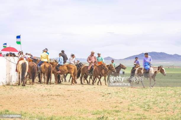 Mongolians on horseback at a village festival in central Mongolia.