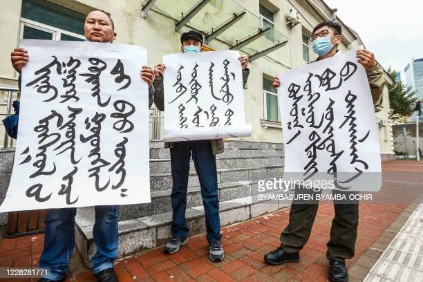 Mongolians protest at the Ministry of Foreign Affairs in Ulaanbaatar, the capital of Mongolia, against China's plan to introduce Mandarin-only...